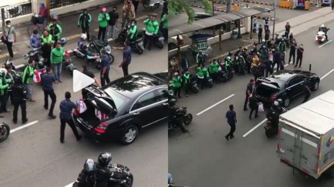 Viral Jokowi Bagi Sembako dari Mobil, Publik: Sekelas Presiden Kok Caranya Begitu?
