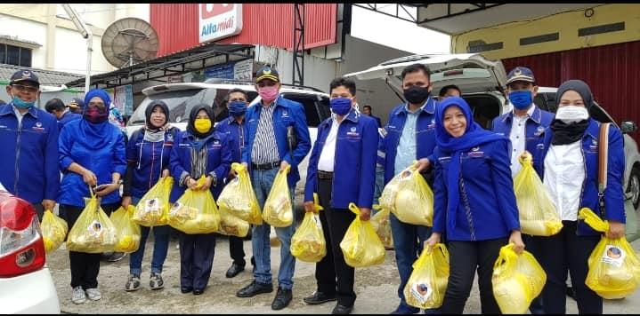 Turun Tangan Cegah Penyebaran Virus Corona, Partai NasDem Kaltim Sumbang Masker dan Bagikan Sembako